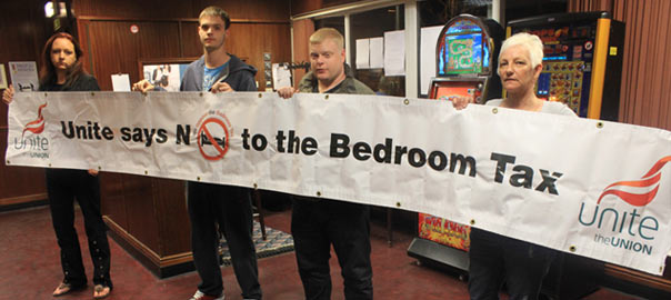 Parson Cross residents hold up a Benefit Justice banner at Colley Working Mens Club yesterday.